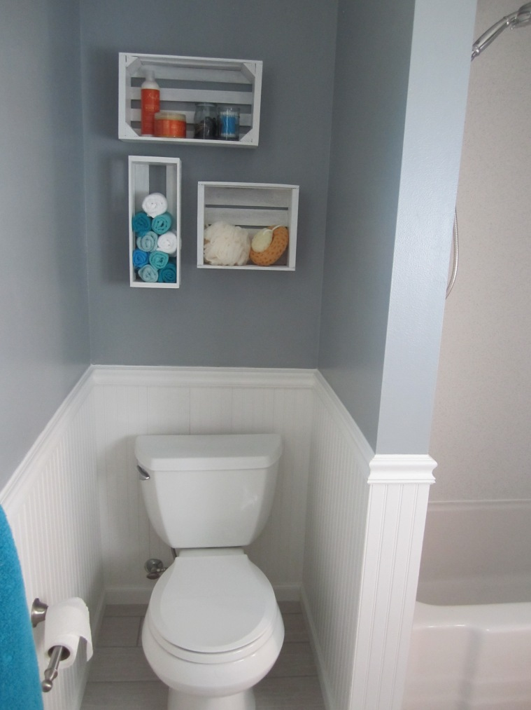 New shelves, new toilet, new wainscoting, and you can even catch a glimpse of the tile floor!